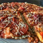 A high protein and low carb skillet pizza that's ready in 15 minutes on the stovetop. You can top it however you'd like, but the recipe creates a pizza with 90 calories and 12 grams of protein per slice!