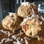Quick and easy toasted almond and coconut no bake protein bites with 8 grams of protein and only 97 calories per bite. These make for the perfect snack on the go or sweet tooth or cravings fix.