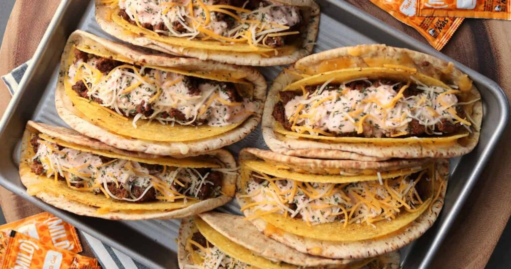 copycat cheesy gordita crunches on a baking sheet