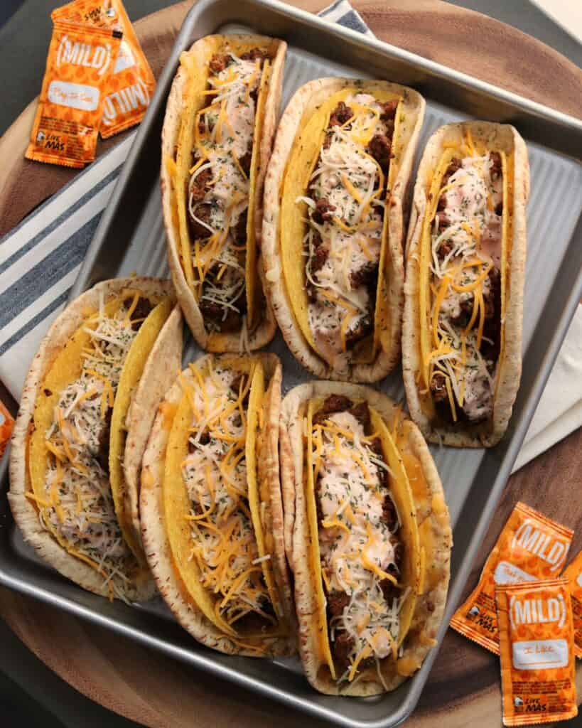 cheesy gordita crunch copycats on a baking sheet