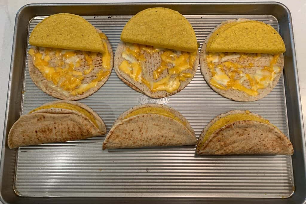 taco shells inside the pitas with melted cheese