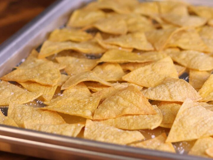 low calorie tortilla chips on a baking sheet