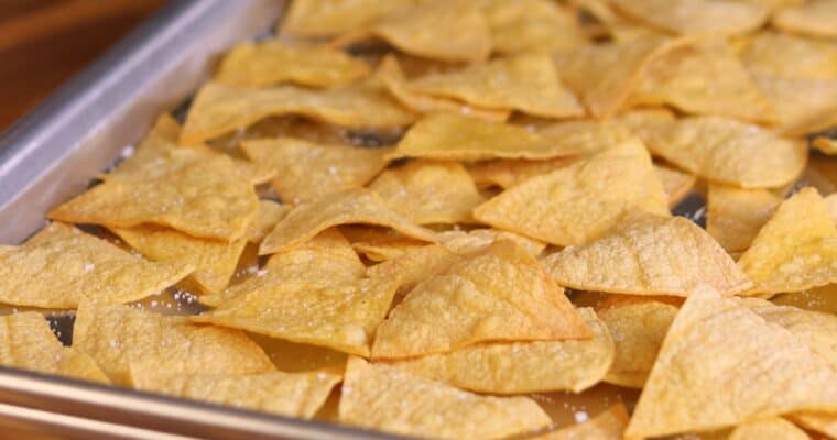 low calorie tortilla chips on a baking sheet
