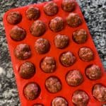 meatballs in a muffin mold before baking
