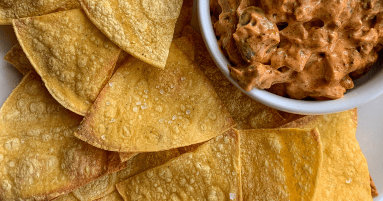 tortilla chips on a plate with dip