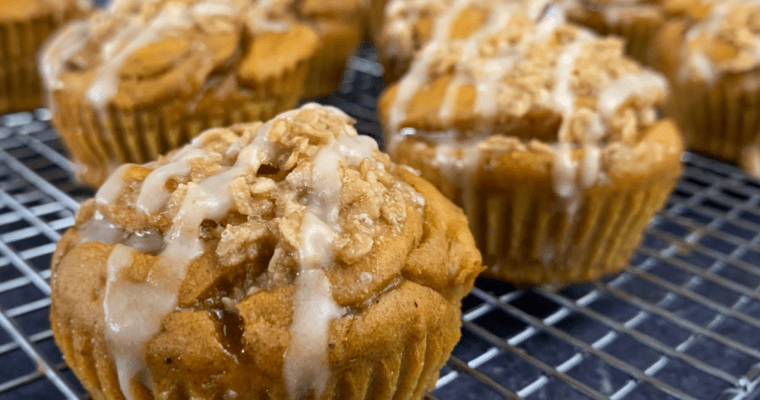pumpkin banana bread protein muffins on a wire rack