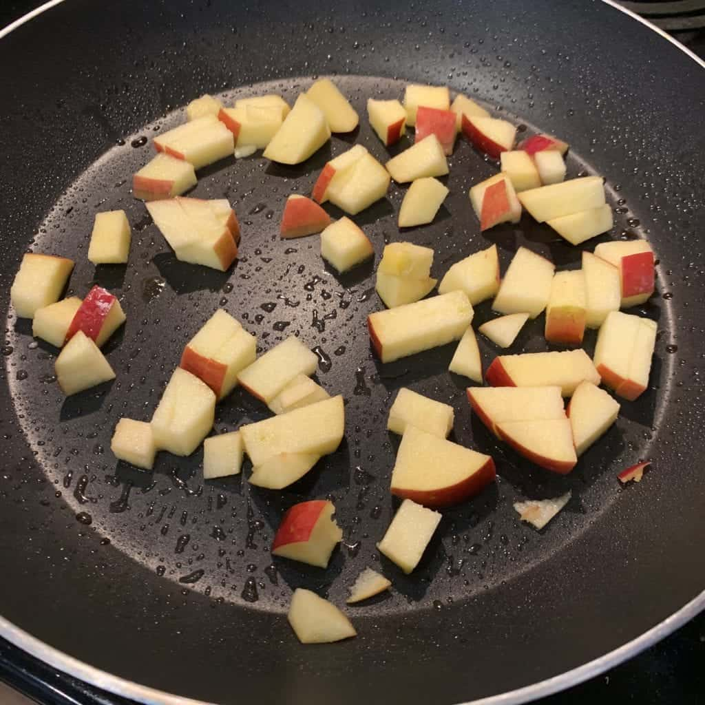 diced apples in a skillet