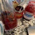 raspberry preserves and chipotle peppers in a blender cup