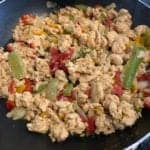 cooked egg whites with peppers in the skillet