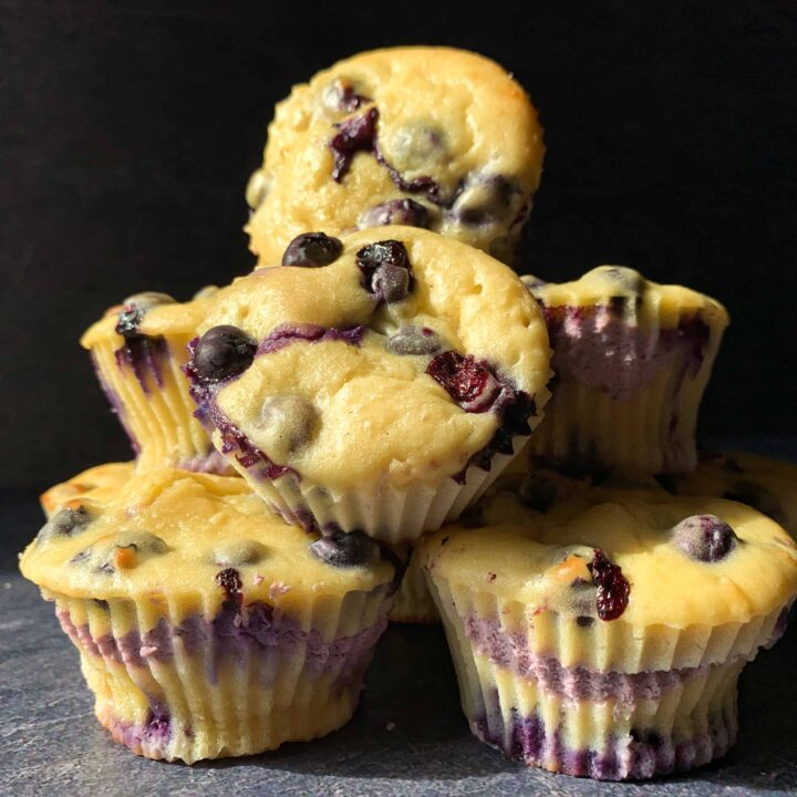 a pyramid of high protein blueberry cheesecake muffins