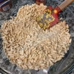 protein granola dry ingredients in a mixing bowl