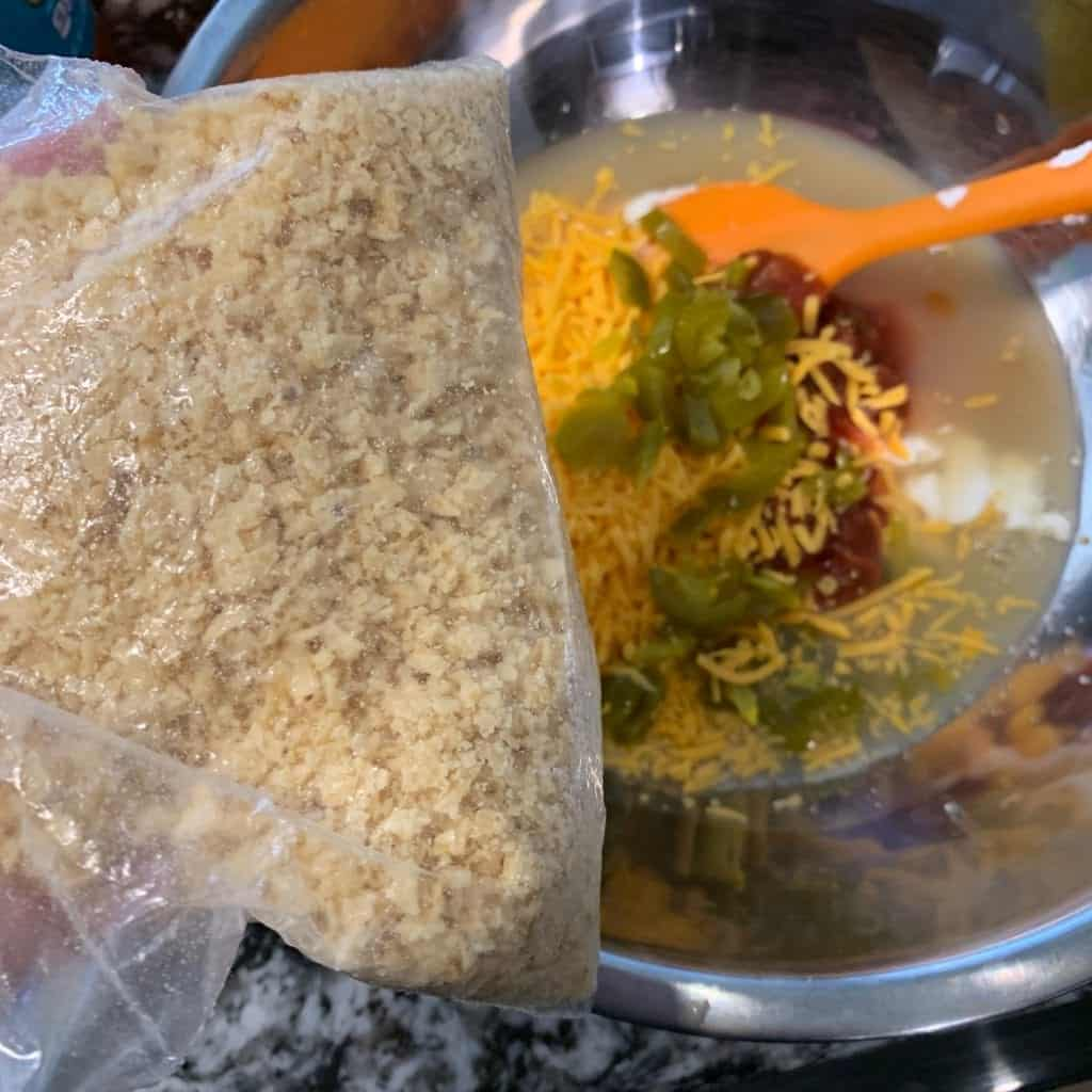 tortilla chips crushed in a plastic bag over the liquid taco bites ingredients