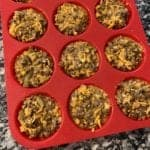 a red silicone muffin mold with taco bites inside