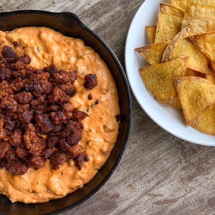 skillet with chorizo dip and plate with tortilla chips
