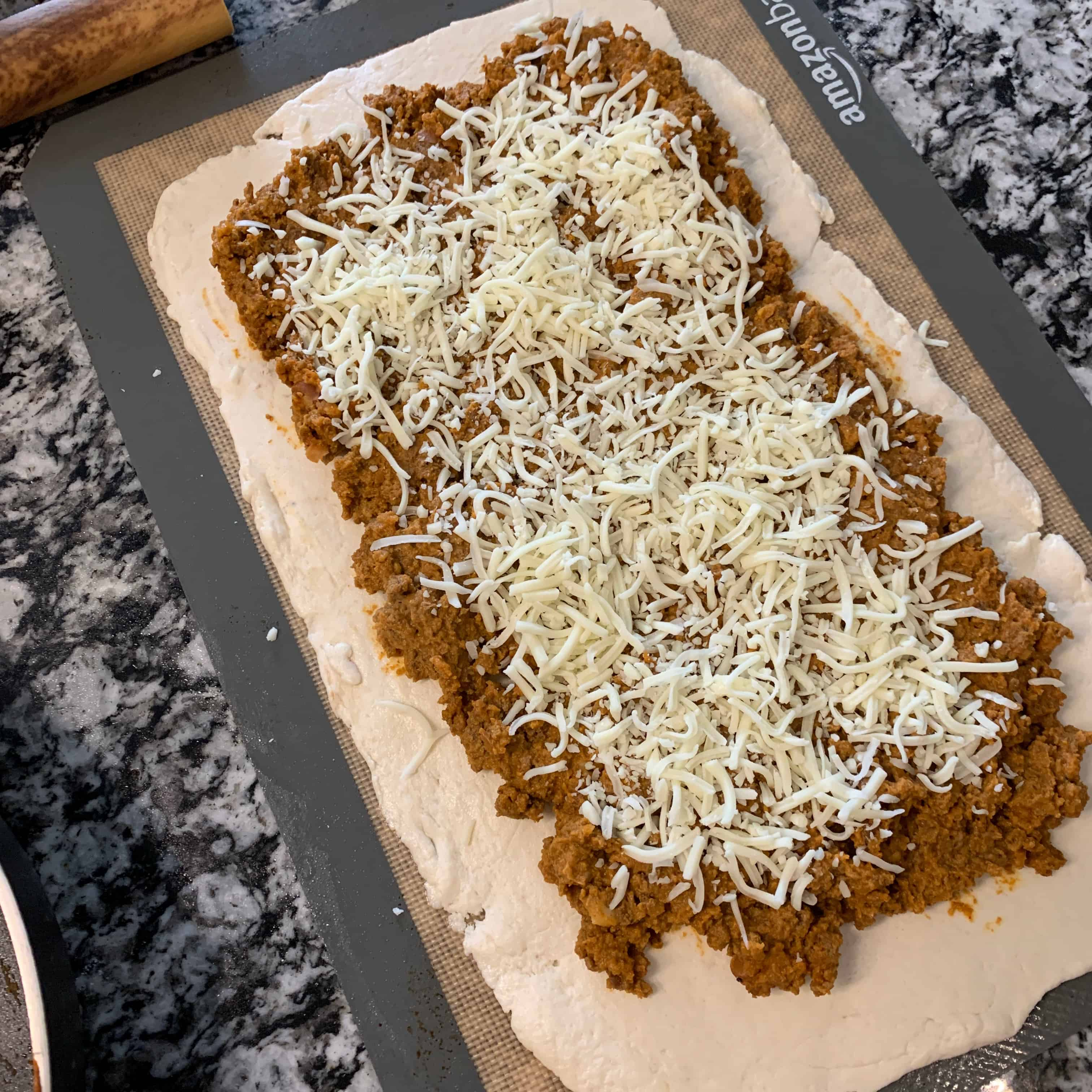 2 ingredient dough topped with beef and cheese
