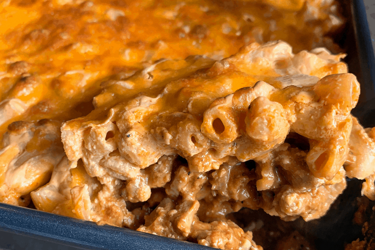 mac and cheese bake with bbq pork underneath in a baking dish