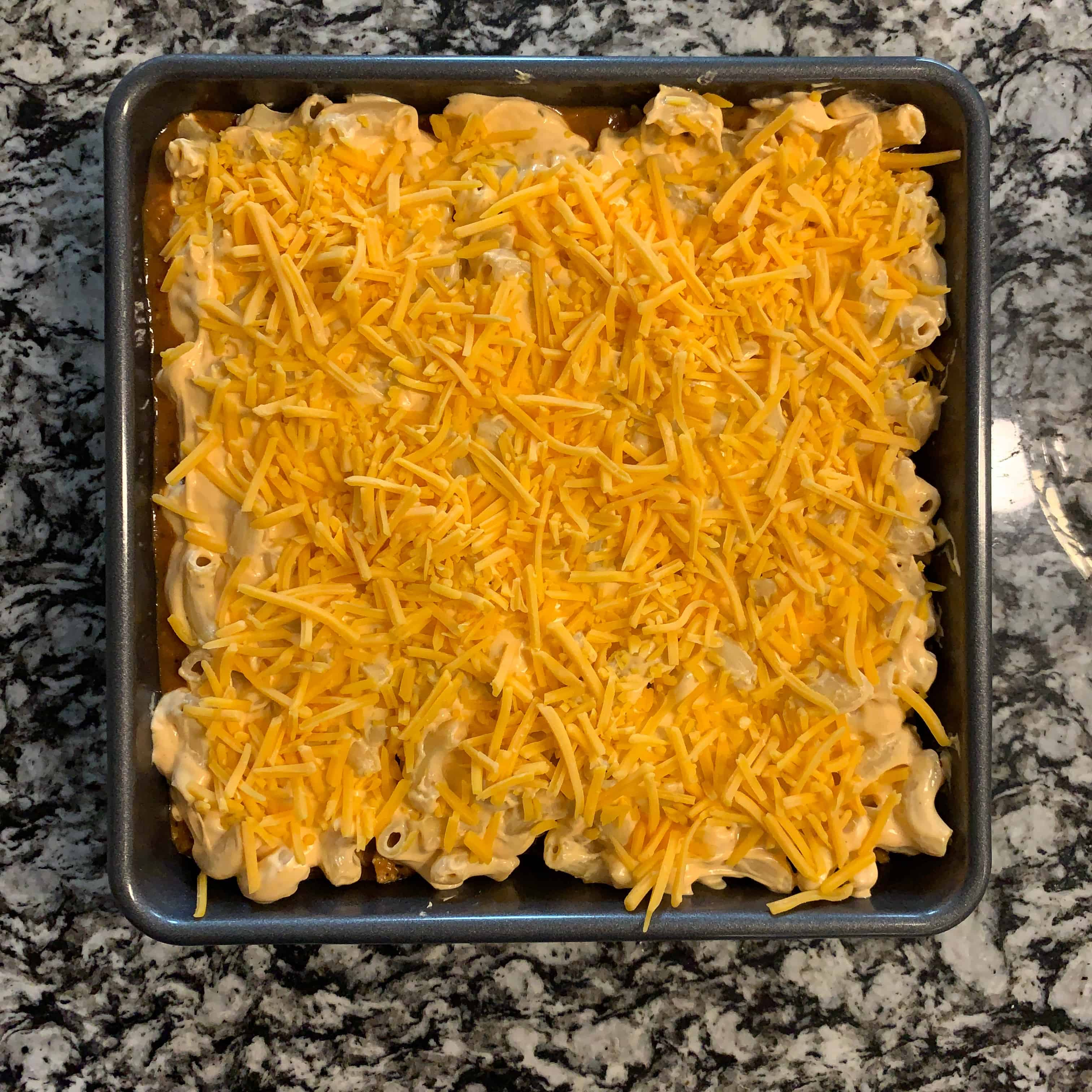 shredded cheddar on top of the low calorie mac and cheese bake