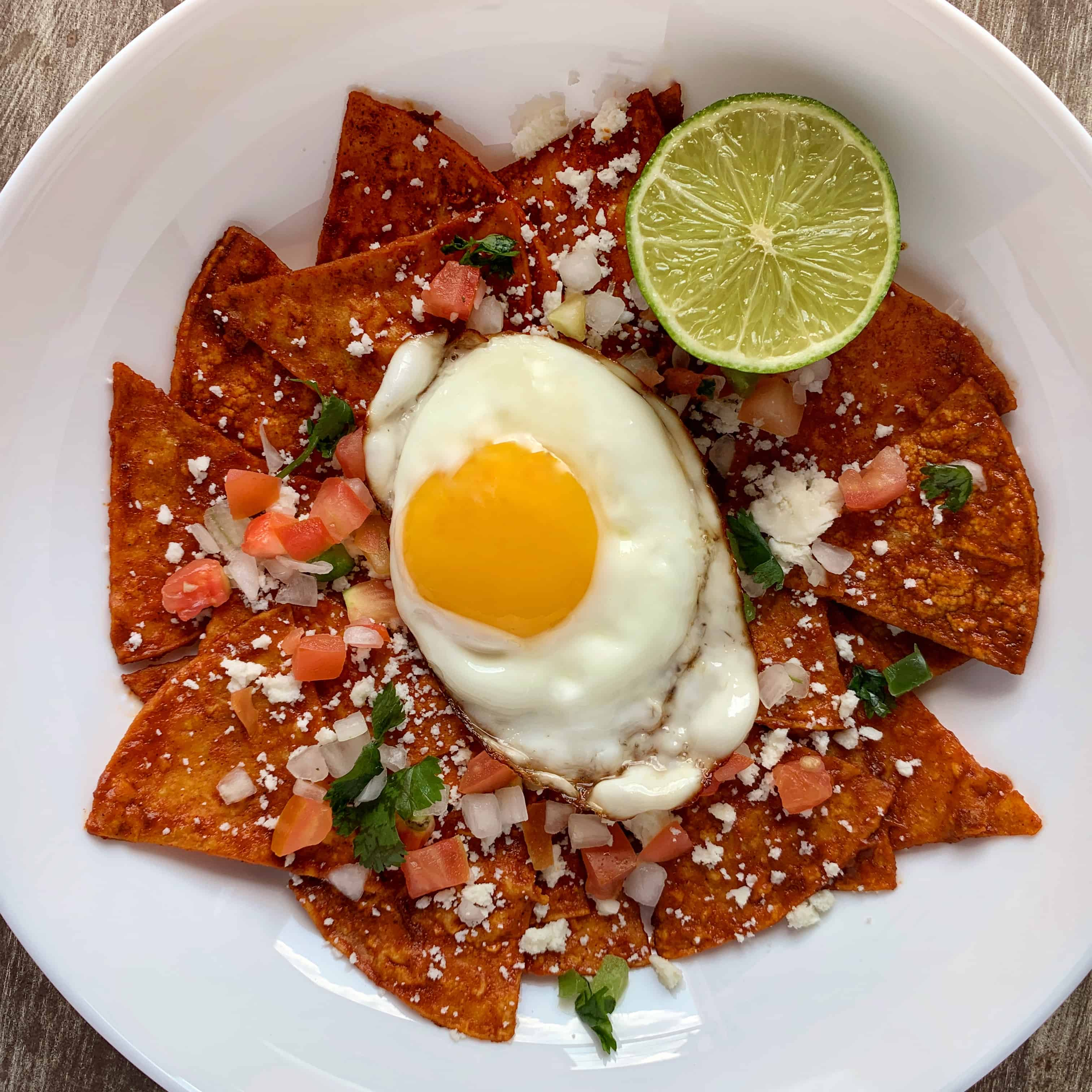 healthy chilaquiles in a white bowl
