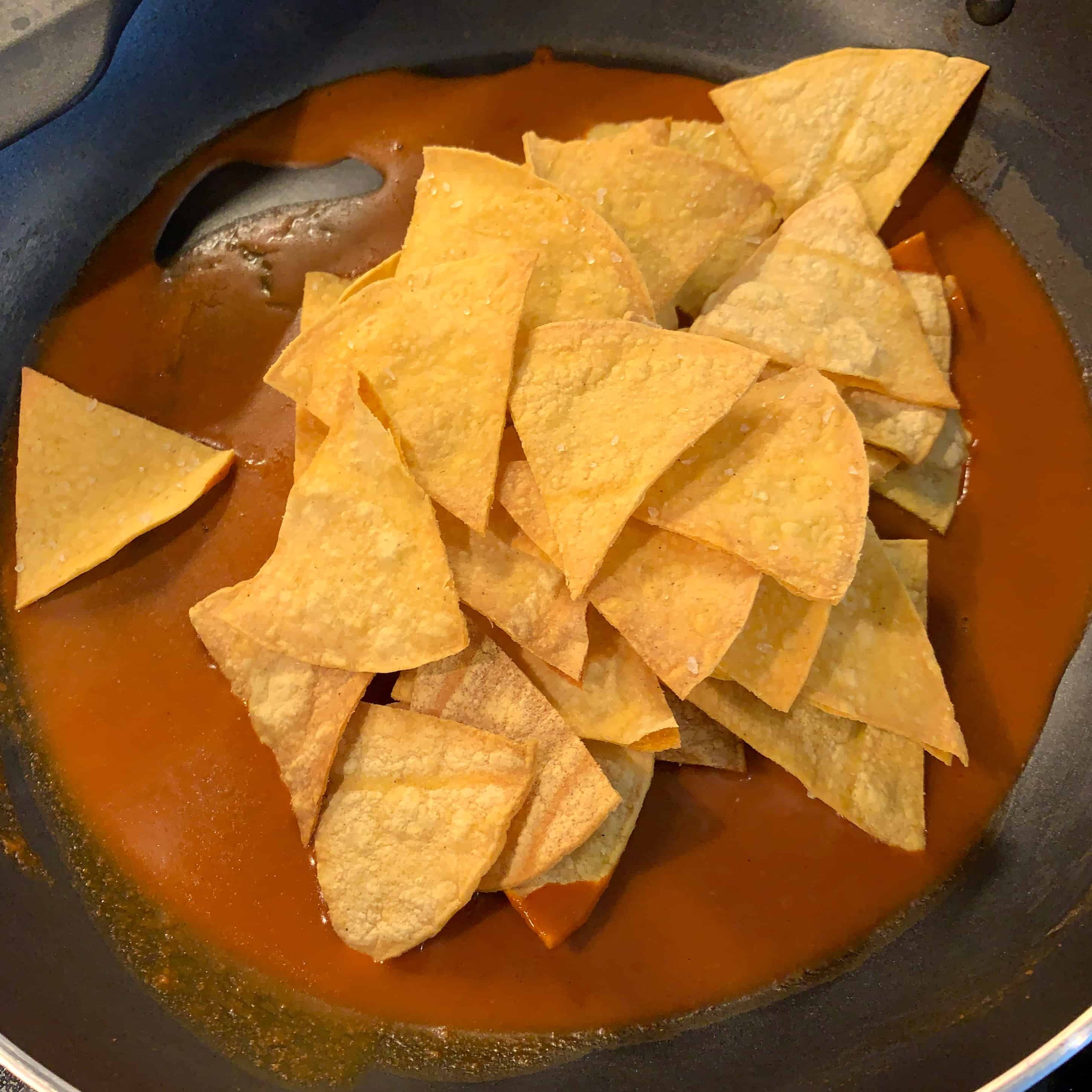baked tortilla chips in enchilada sauce