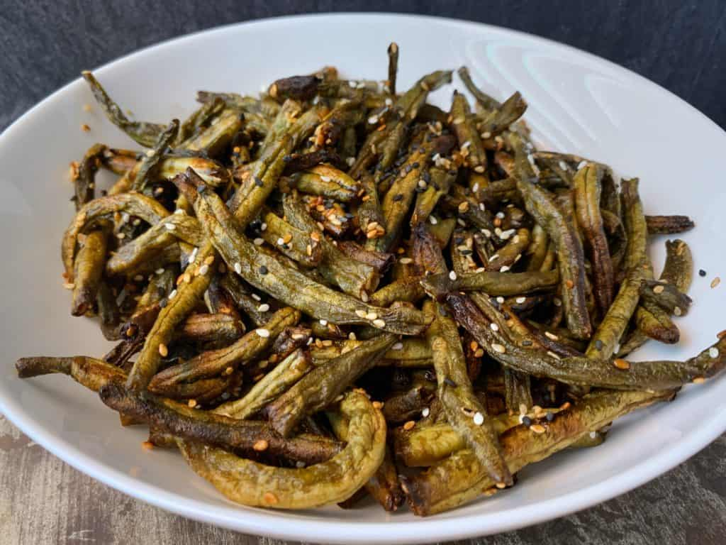air fryer green beans tossed in sesame seeds and chili oil