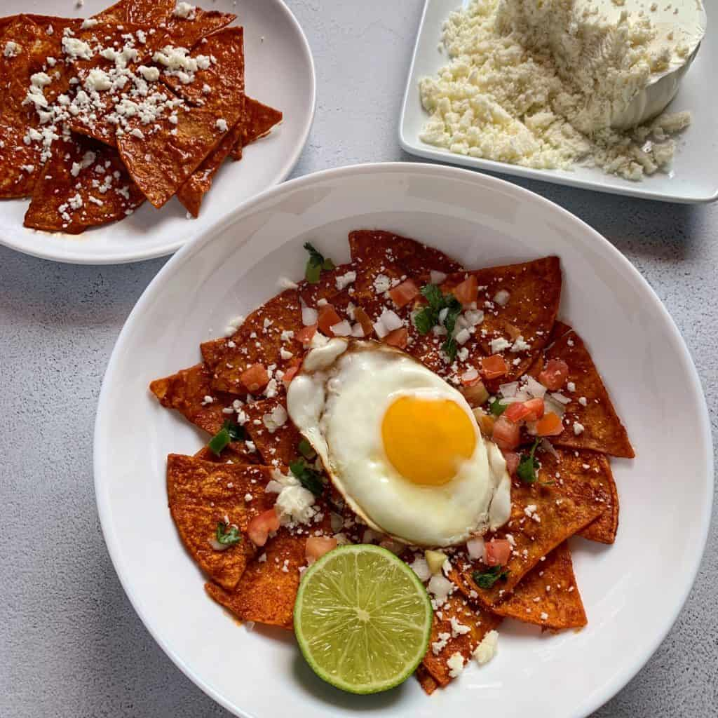 healthy chilaquiles rojas in a white bowl