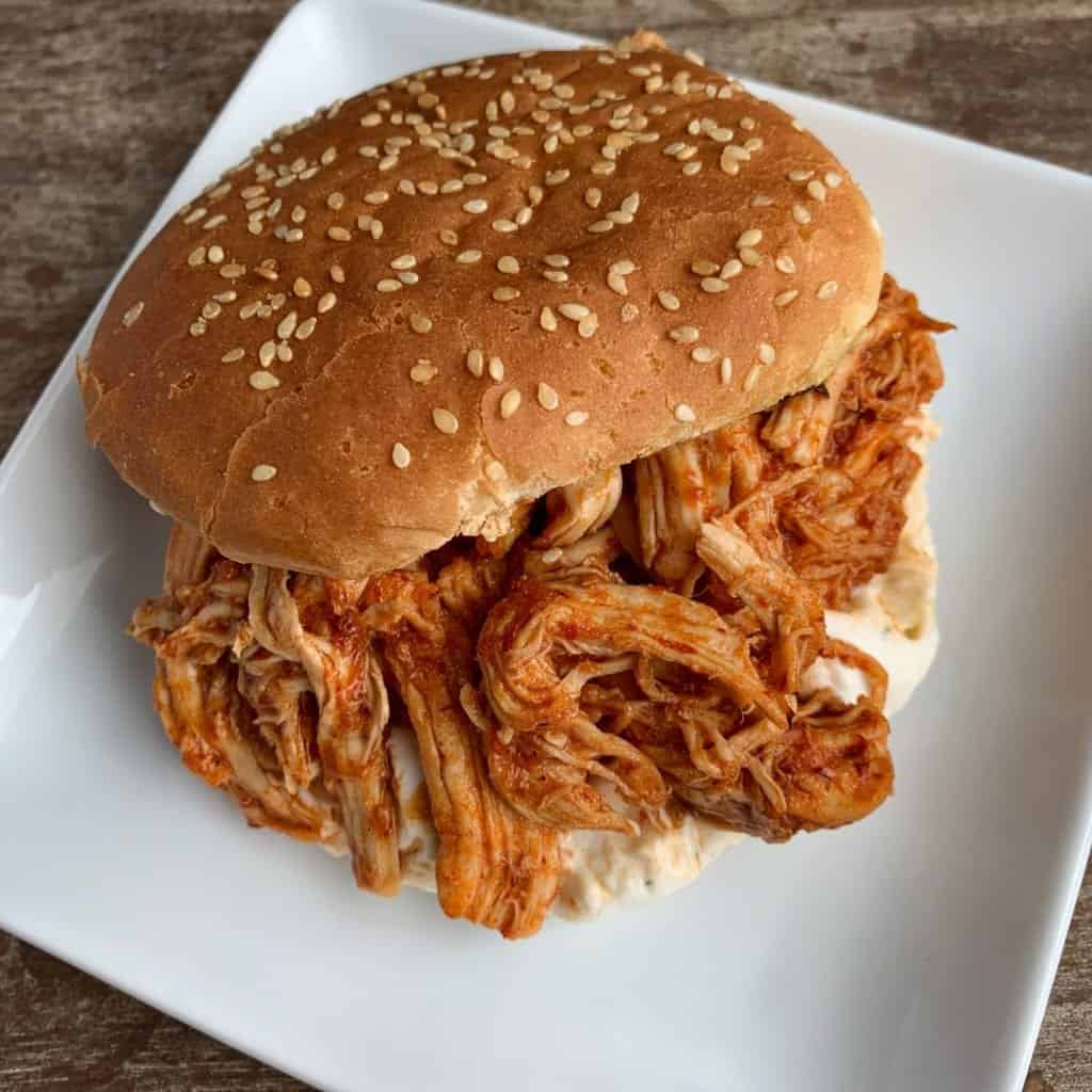 honey chipotle pulled chicken sandwich on a plate