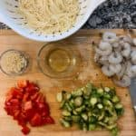 ingredients for kung pao shrimp noodles on a cutting board
