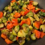 bell pepper and brussels sprouts in a skillet