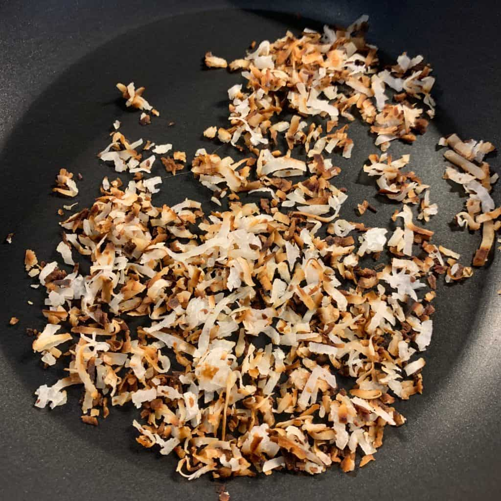 toasted coconut flakes in a pan