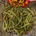 green beans tossed in the sesame seed and oil mixture