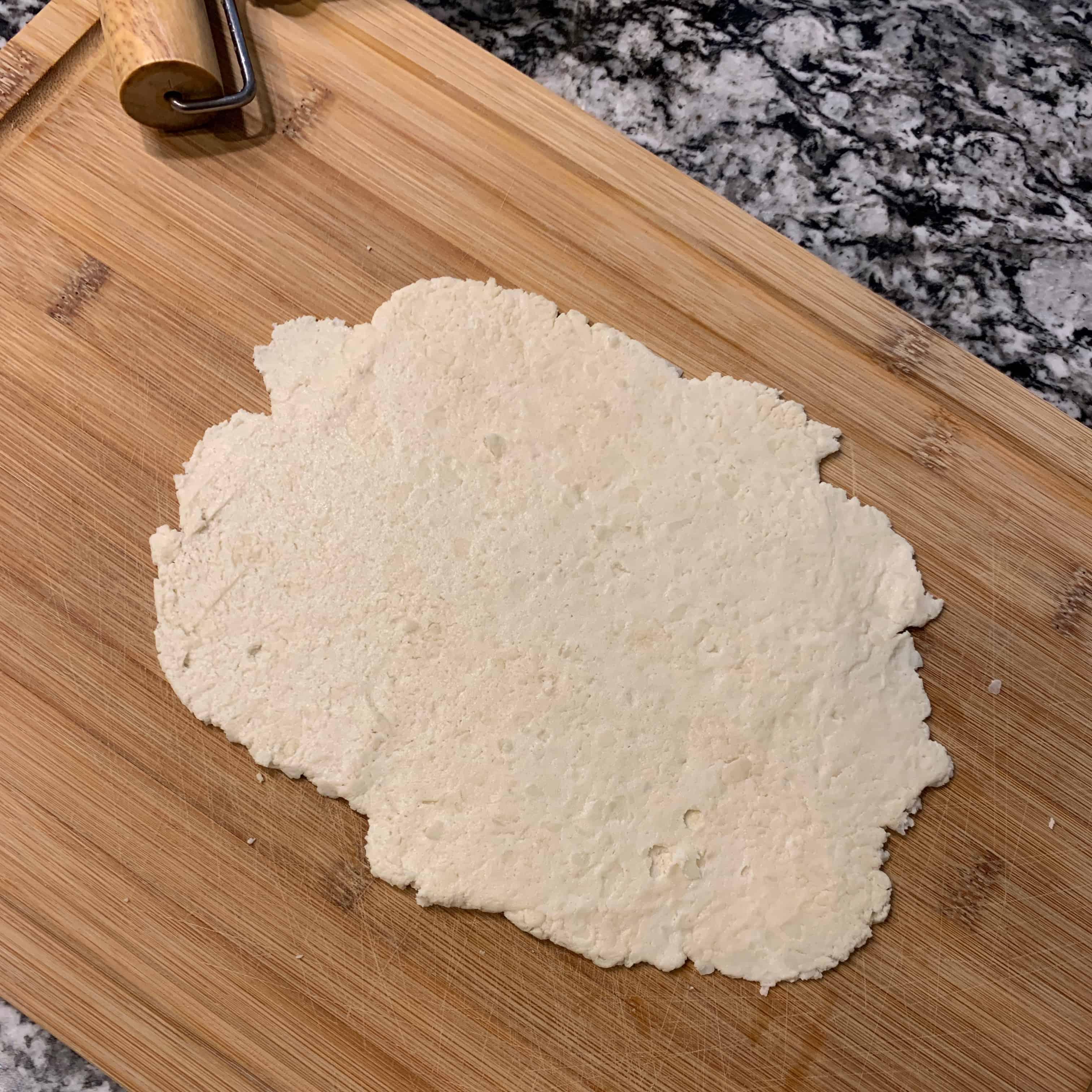 cinnamon roll in a mug dough rolled flat