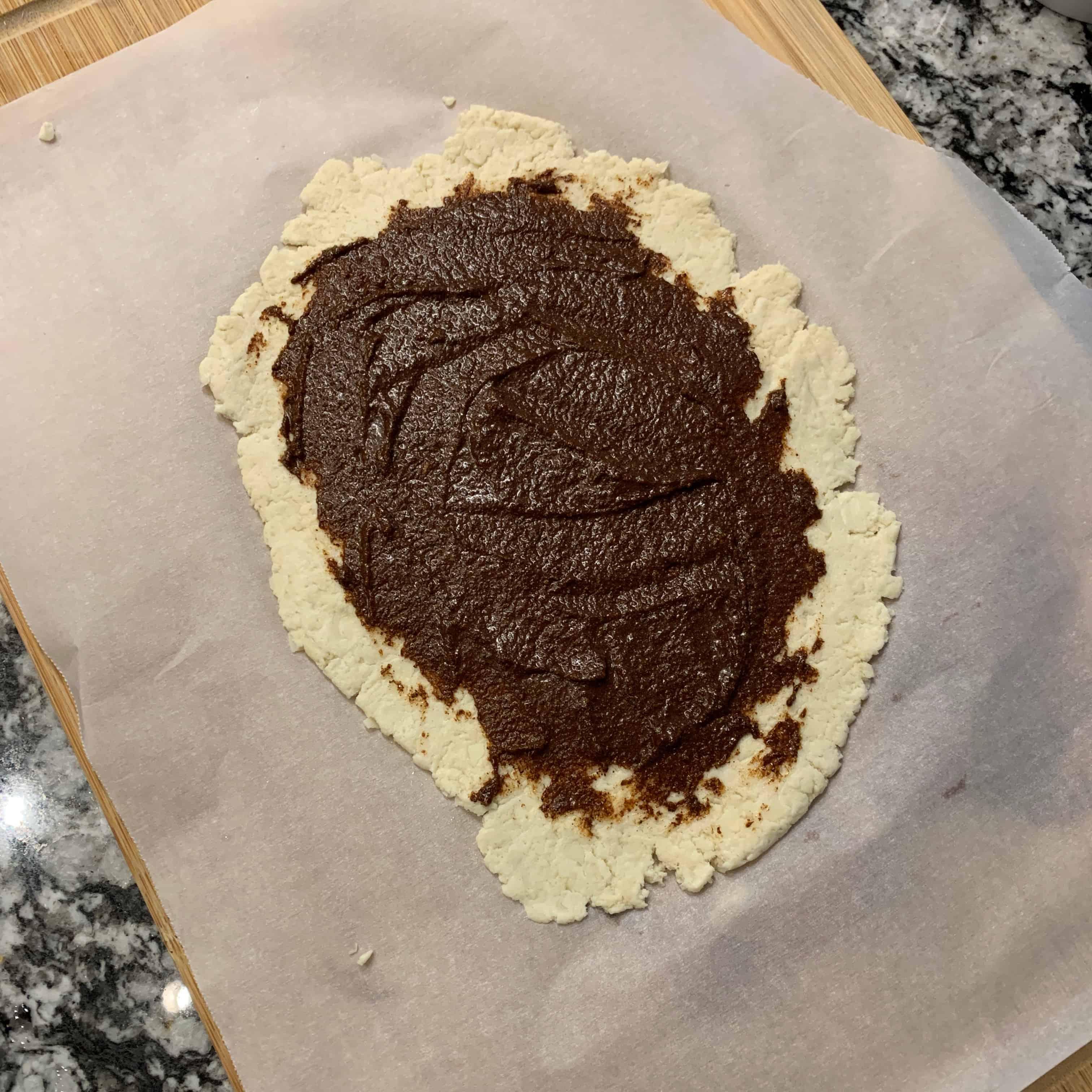 cinnamon sugar butter spread over the cinnamon roll dough