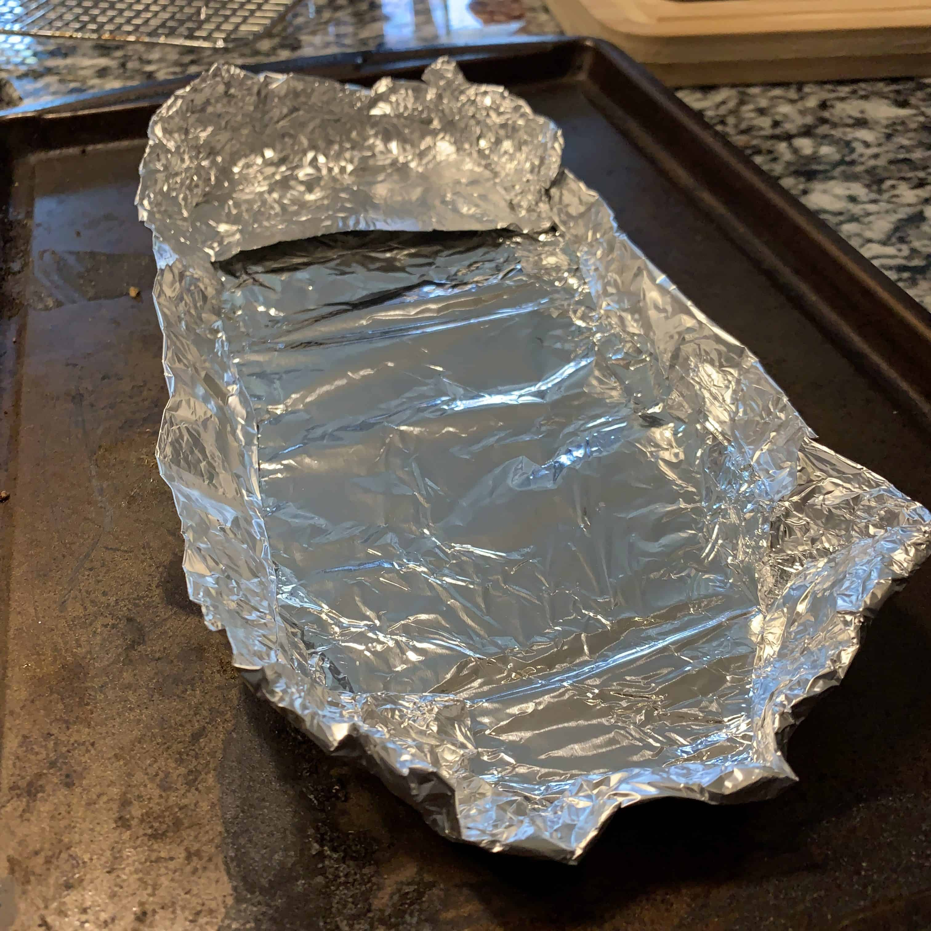 aluminum foil in a rectangle with raised edges