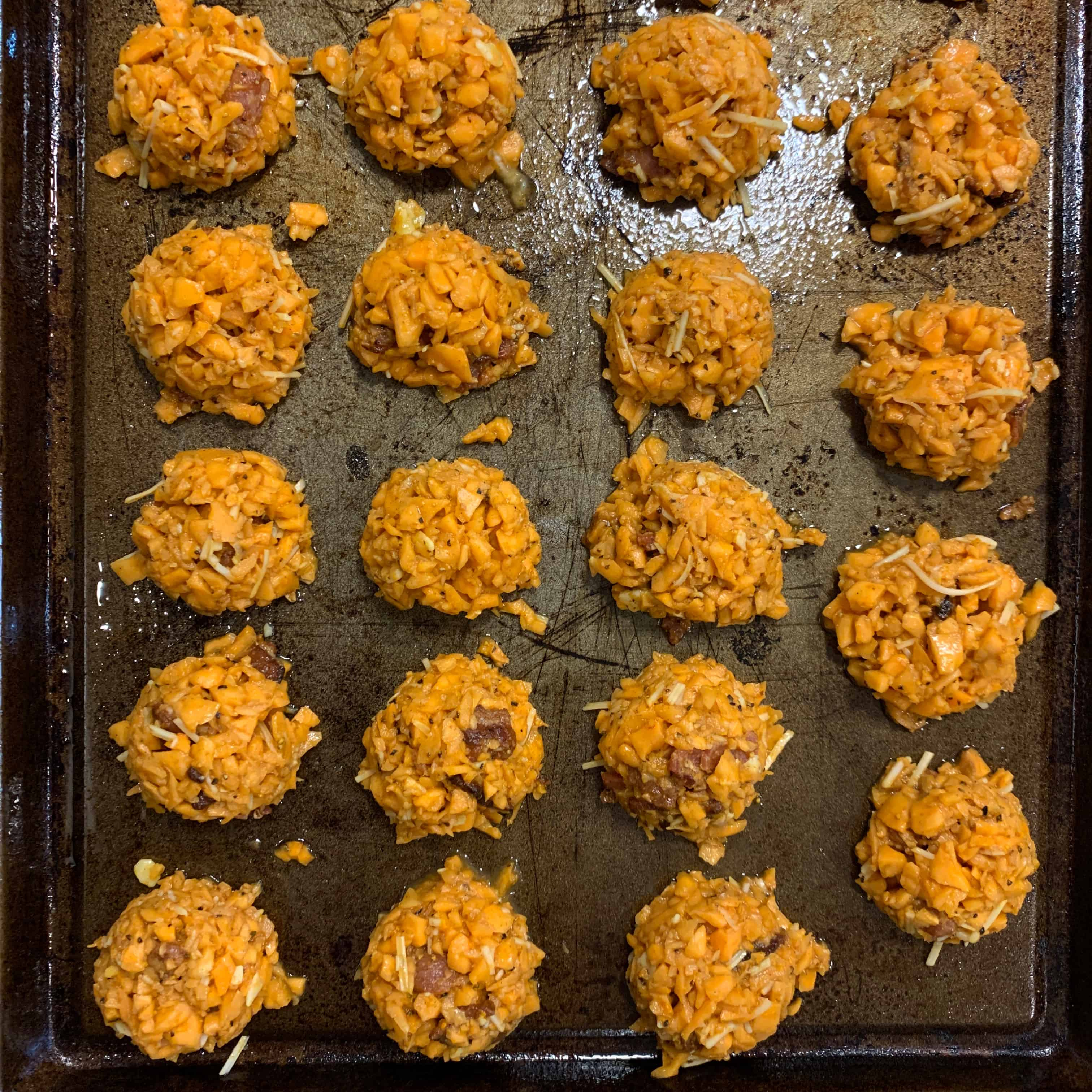 sweet potato tots on a baking sheet before baking
