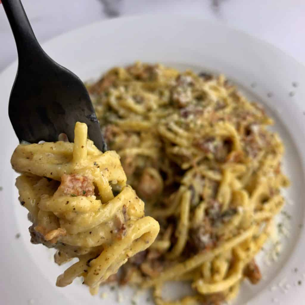 low carb pasta carbonara twirled on a fork