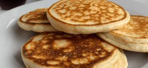 protein powder pancakes on a white plate
