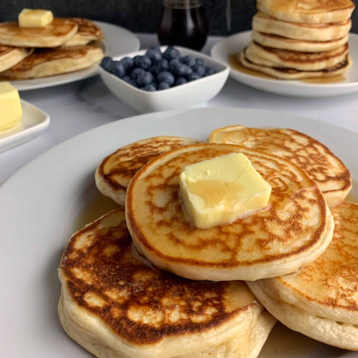 protein powder pancakes on a plate with butter and syrup