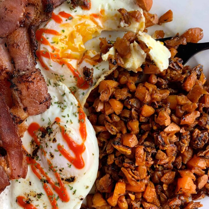 sweet potato hash browns with a fried egg and bacon