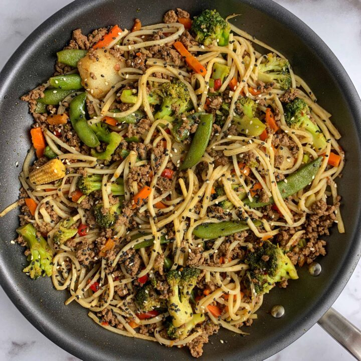 five spice ground beef stir fry with noodles in a pan
