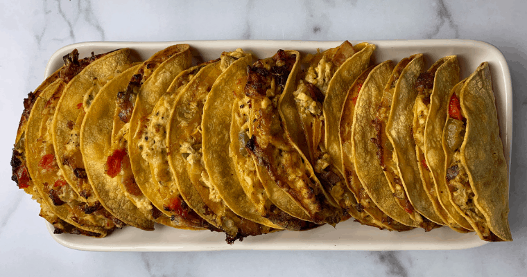healthy breakfast tacos lined up on a plate