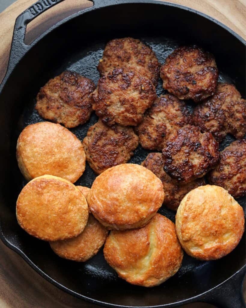 chicken breakfast sausage in a cast iron skillet with biscuits