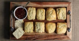Greek yogurt biscuits on a wooden tray with fig butter