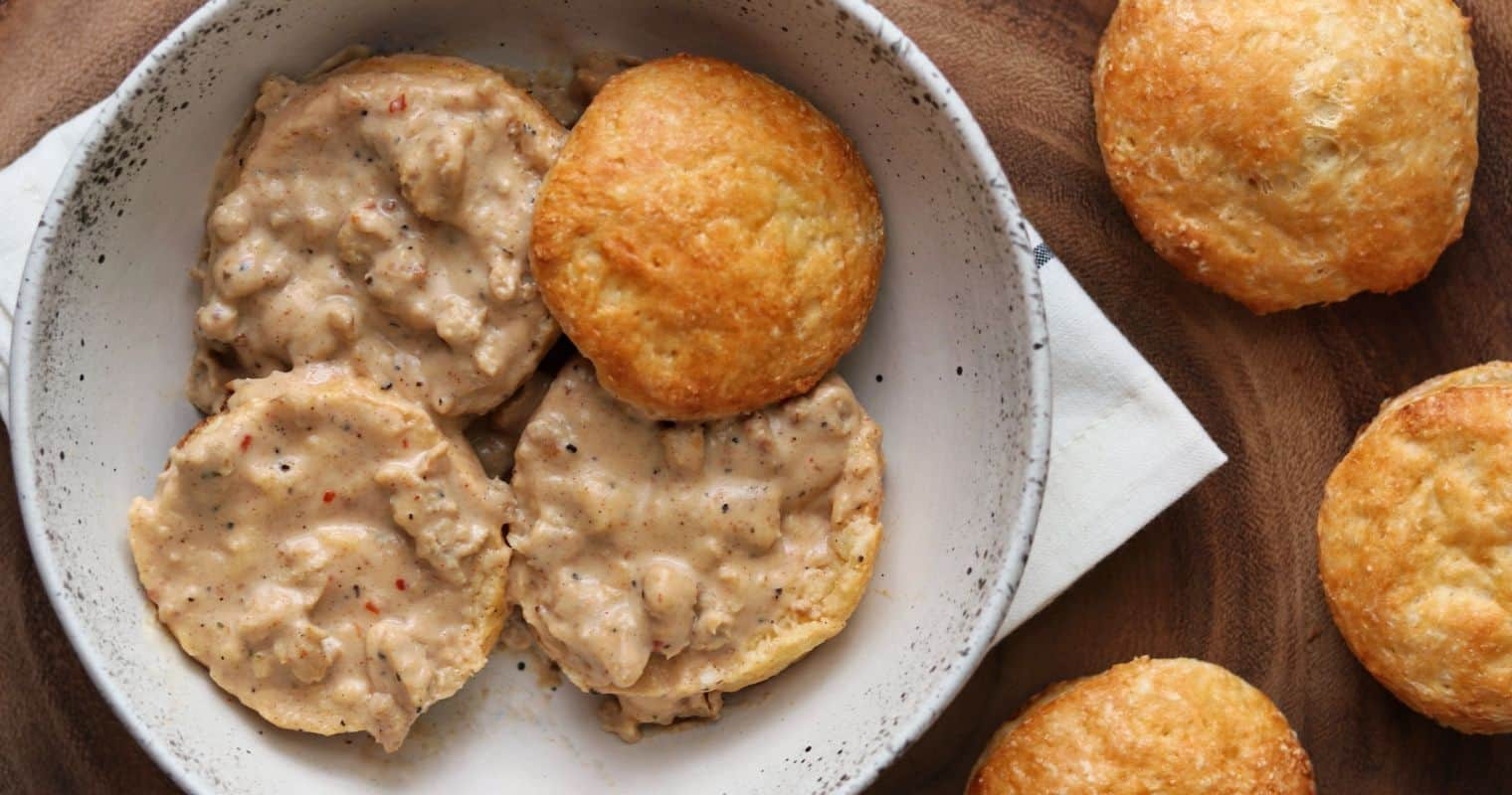 healthy sausage gravy on top of biscuits in a bowl