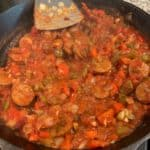 thickened tomato sauce in the veggie and sausage mixture