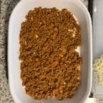 add a fifth of the lasagna meat sauce to the baking dish