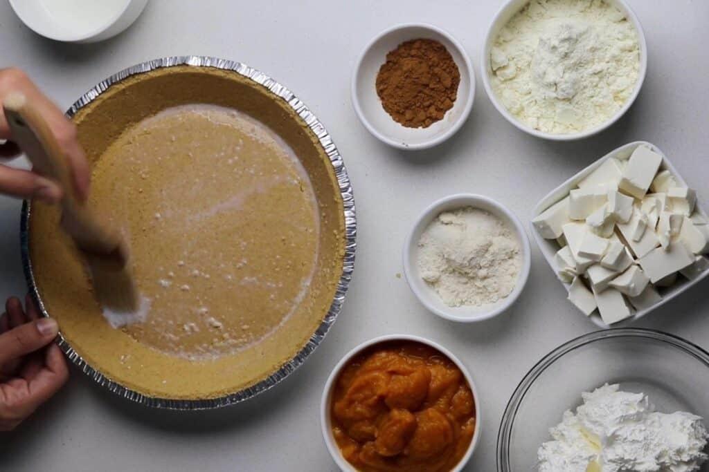 brushing pie crust with skim milk