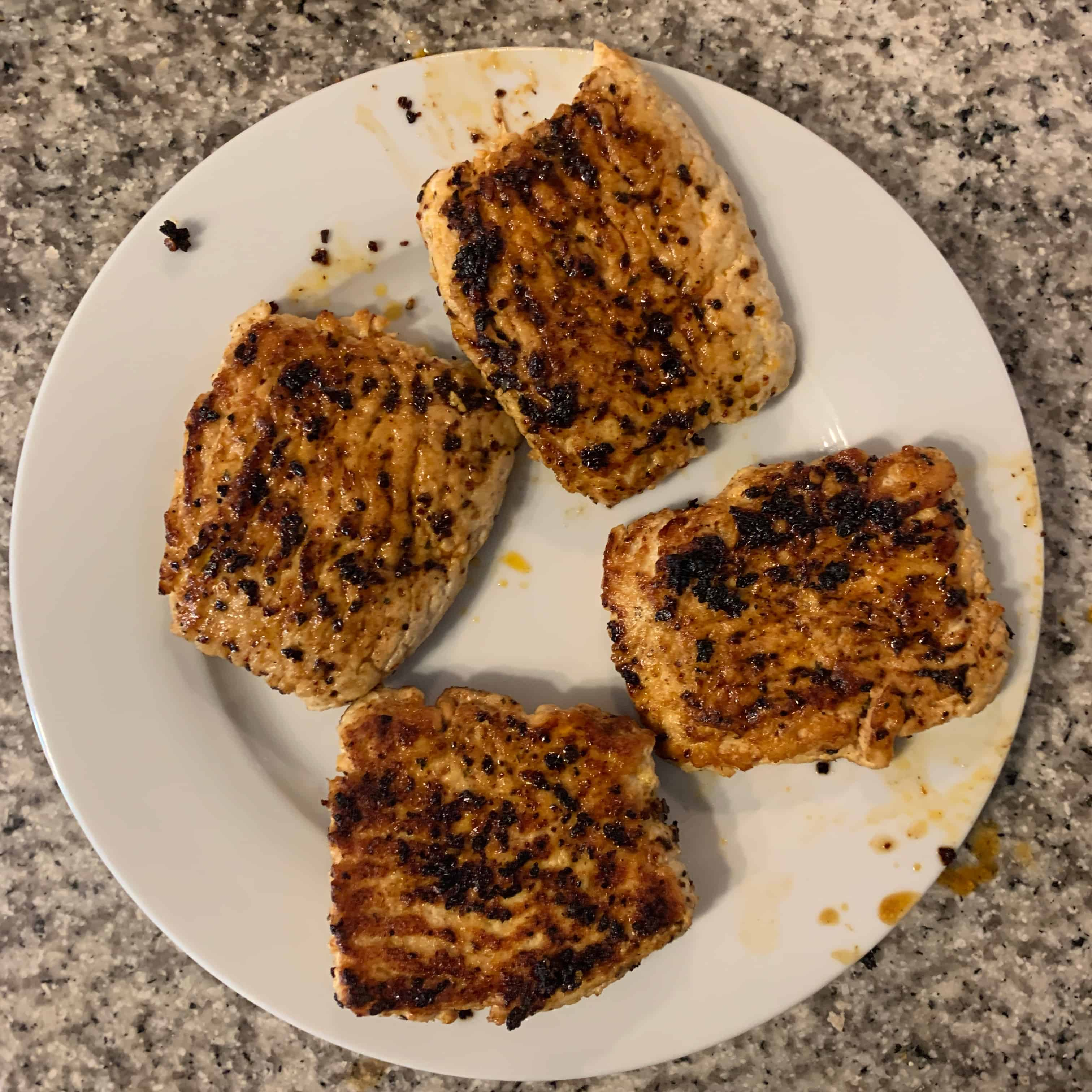 cooked chicken burgers on a plate