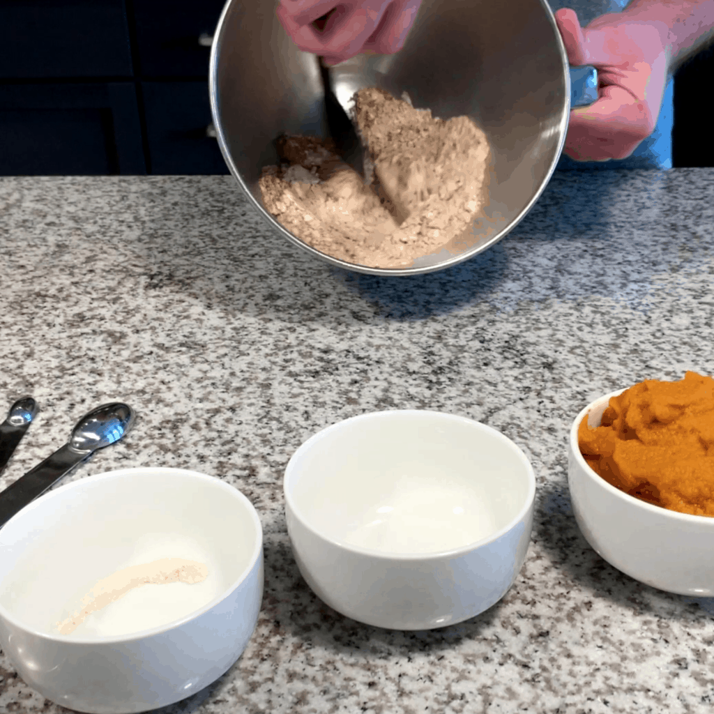 mixing the dry ingredients for pumpkin pie cheesecake