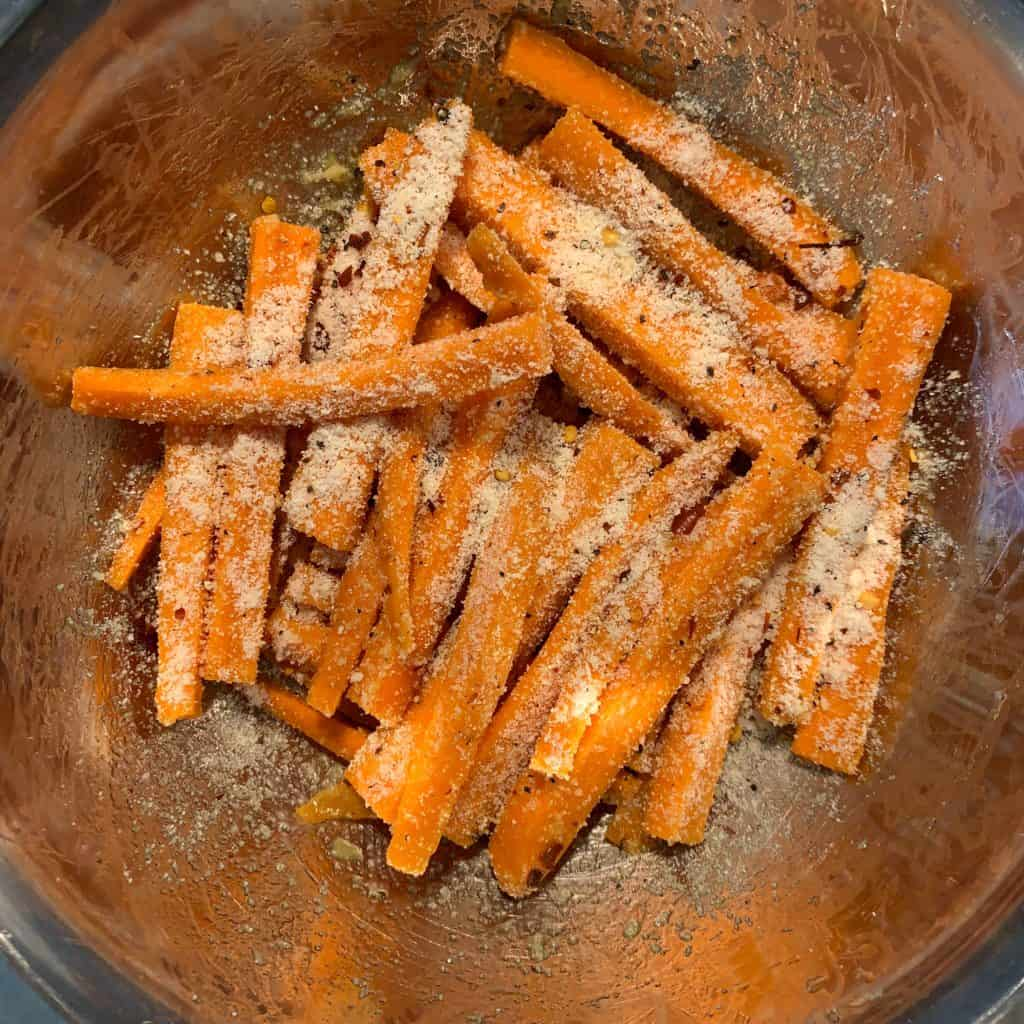 grated parmesan on oil coated carrot fries