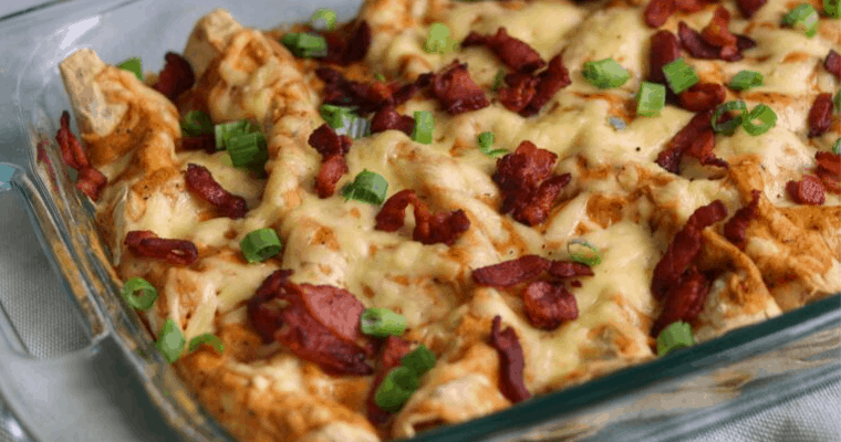 bacon gouda breakfast enchiladas in a glass baking dish